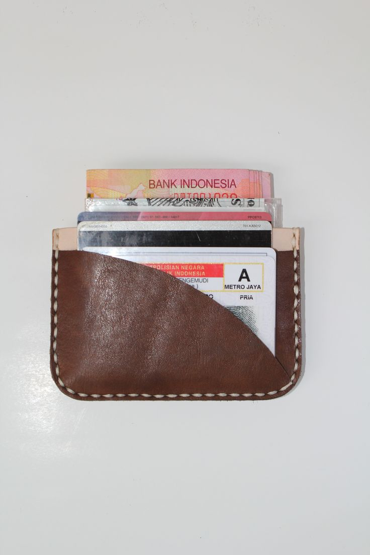 """Keeping it slim with 10 folded bills, 4 credit cards, a driver license and ID card ? We've done it with our """"Ark 02"""" card wallet   #holarocka #handmade #leathergoods #slimwallet #local #brand #indonesia"""