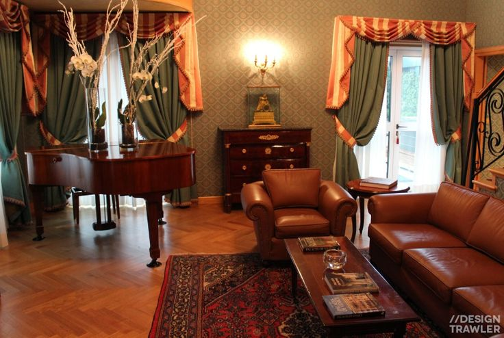 Westin Palace, Milan: Grand piano with oversize vases and French doors to the terrace
