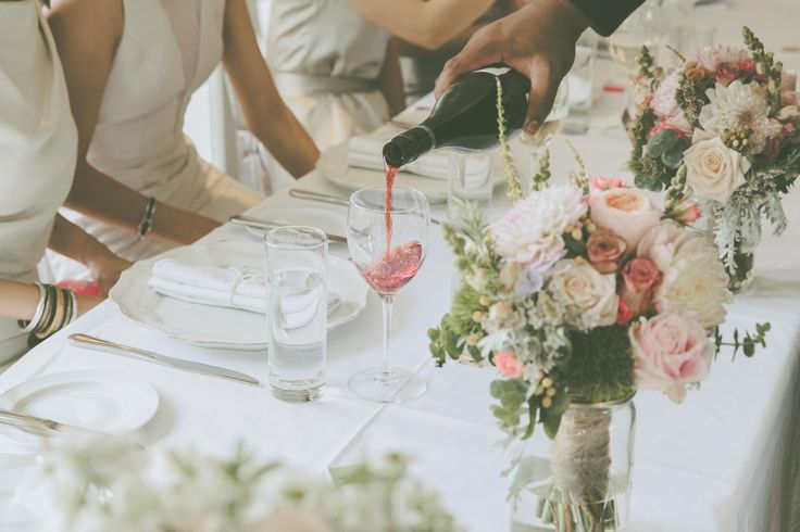 bridesmaids bouquets creating a pretty head table
