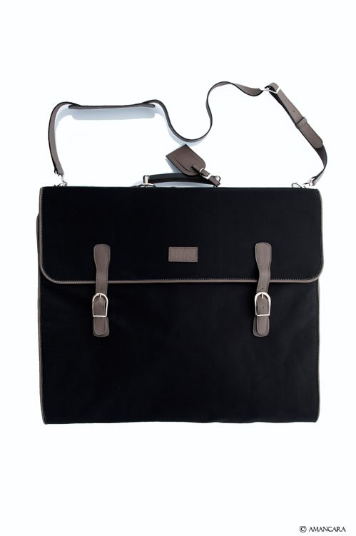 A garment bag made with technical fabrics with genuine leather details. Hang it in armoire and your suit is ready to wear.