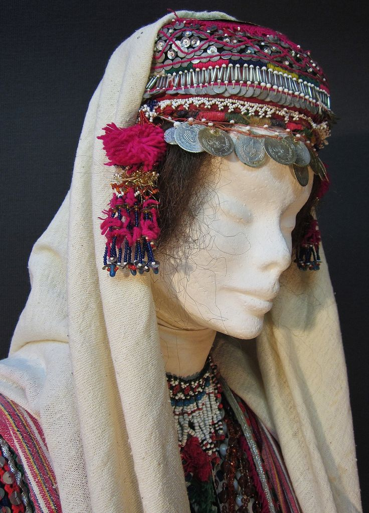A traditional festive headgear from the Pomak villages near Biga (Çanakkale prov.).  Setting for betrothed young women.  Mid-20th century.  The cap is adorned with metal sequins, glass beads, metal (imitation) Ottoman coins, (cotton or orlon) pom-poms.  (Kavak Costume Collection - Antwerpen/Belgium).