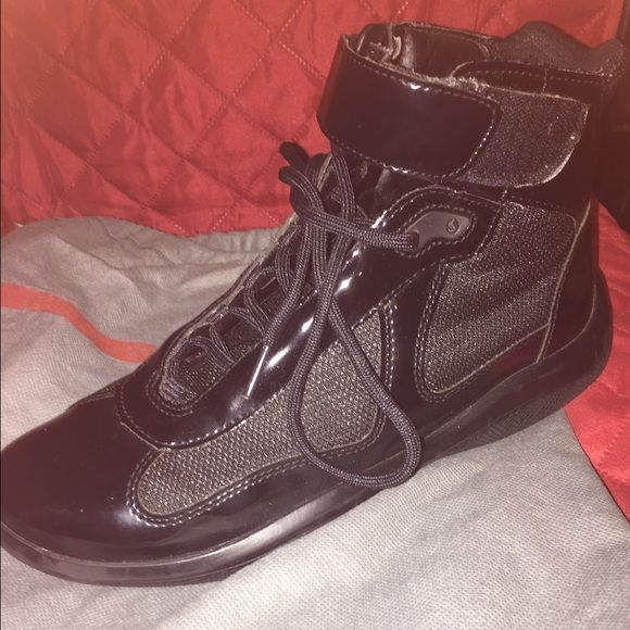 Prada Punta Ala (Glossy) all black MENS sneakers Glossy Prada sneakers, men's size. All black. Wiling to negotiate price, use offer button. These retail for over 500. It good condition, worn only a couple times. Dust bag included. Prada Shoes Sneakers