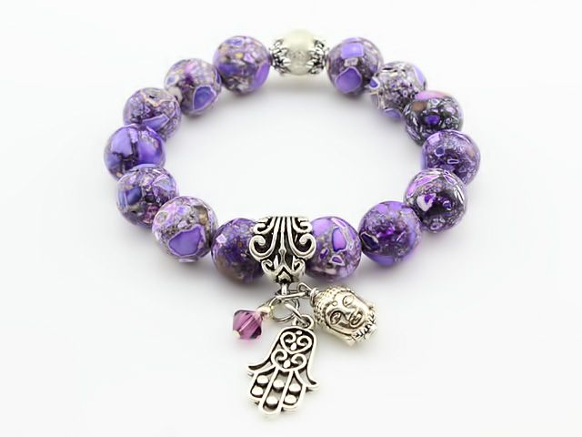 The main focal points of this bracelet are the Buddha, Hamsa Hand and bicone swarovski crystal surrounded by stunning 12mm Purple Mosaic Turquoise Gemstones. It is believed that wearing a Buddha and a Hamsa Hand you will attract good fortune, wealth, harmony and happiness into your life.