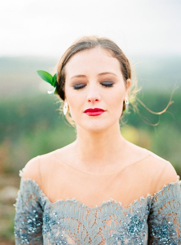 bride with a red lip - photo by 135milimetros http://ruffledblog.com/mountaintop-bridal-inspiration
