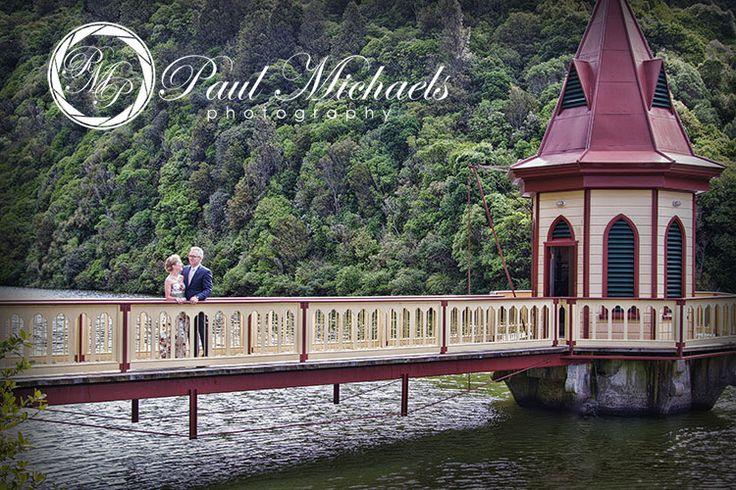 Bride and groon on the bridge at Zealandia wedding venue.