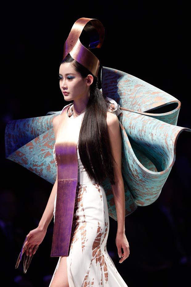 The avant garde Kairos look created for The Hempel Award, China Fashion Week, held in Beijing in March.   Featuring wool garments, copper head piece and breastplate, and patinated wings.