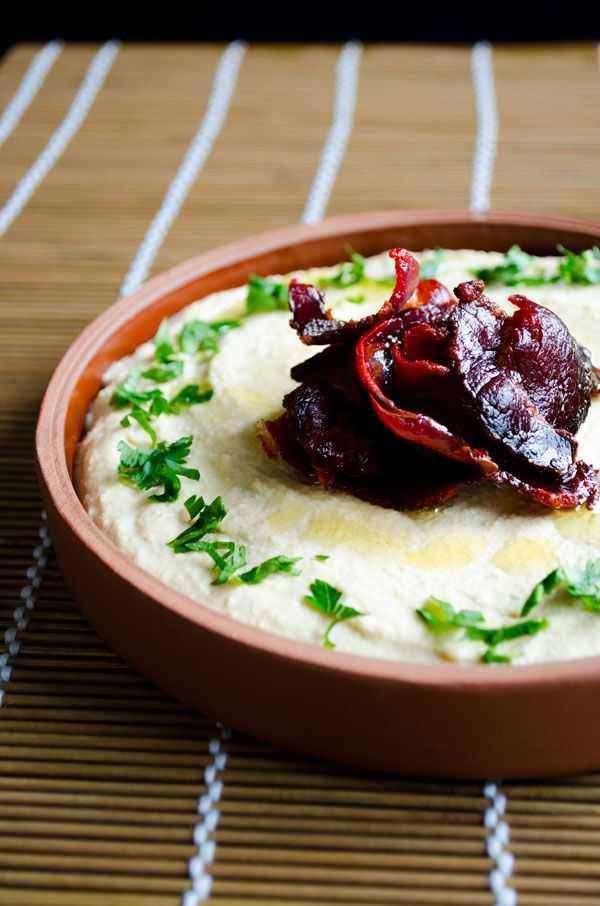Hummus topped with dried beef pastirma or bacon is a heavenly combination. Hummus becomes even more addictive this way!