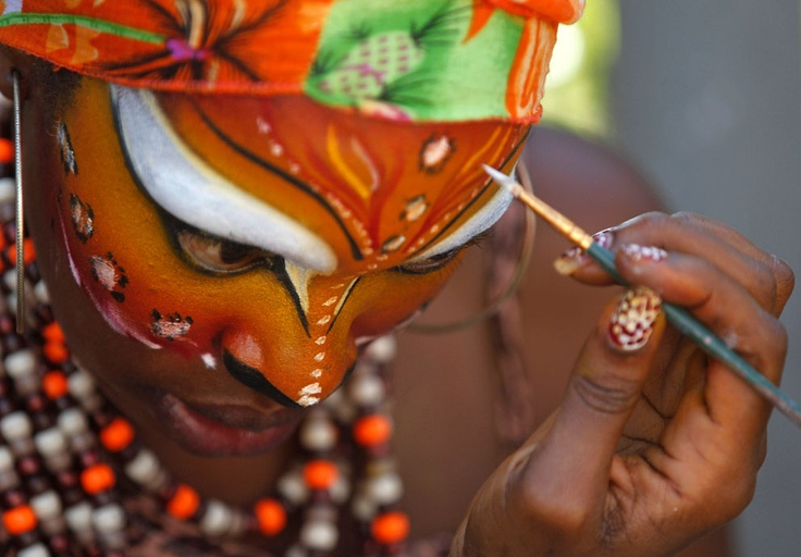 woman applies make-up for carnival celebrations in Barranquilla, Colombia, on February 19, 2012. (AP Photo/Fernando Vergara)