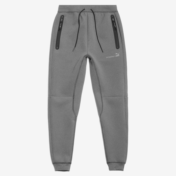 Paneled poly/elastic sweatpants with Bemis taping detail and reflective co-branding. Front and back pockets feature branded zipper pulls with coating. Drawstring elastic waistband.