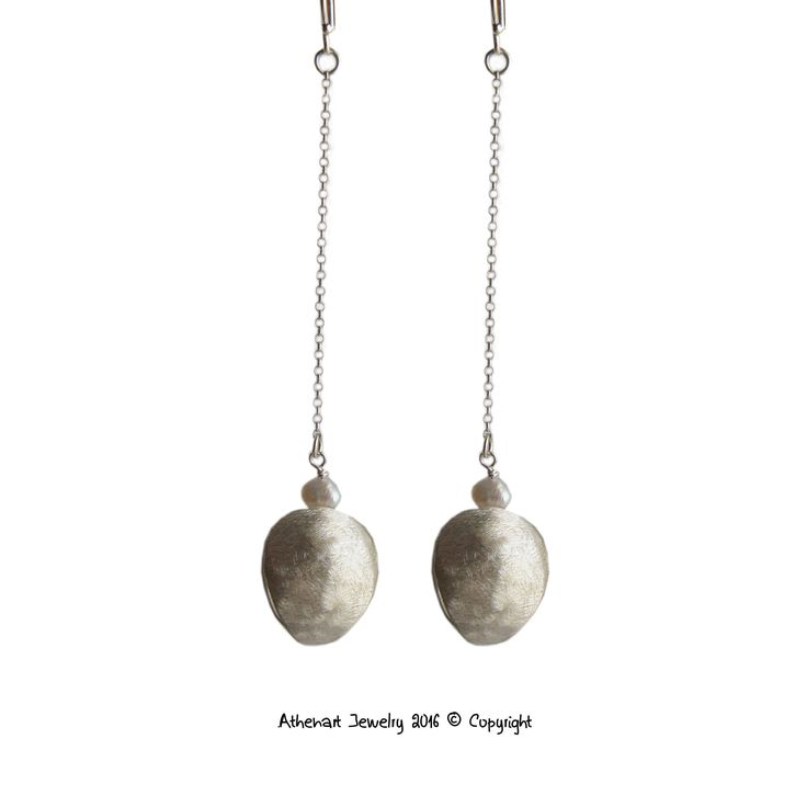 Long silver earrings with pearls,contemporary jewelry designer,luxury jewelry,contemporary jewelry designer