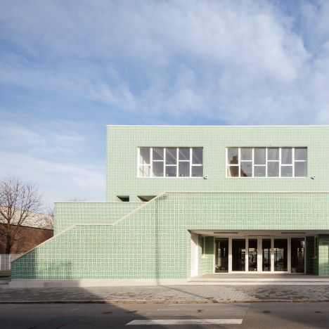 Glossy green bricks lend woven texture to Belgian primary school by Areal Architecten
