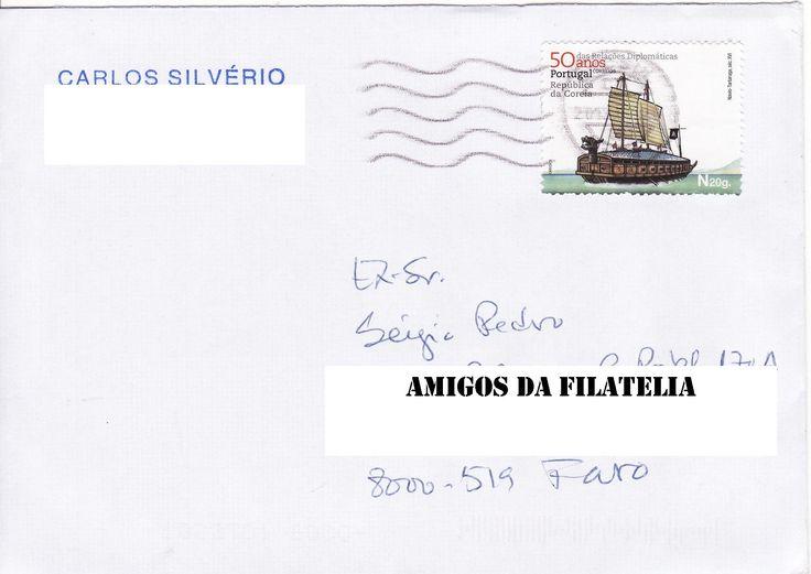 Sobrescrito circulado com selo referente aos 50 anos do estabelecimento de relações diplomáticas entre Portugal e a República da Coreia. O selo tem a imagem de um navio tartaruga do séc. XVI