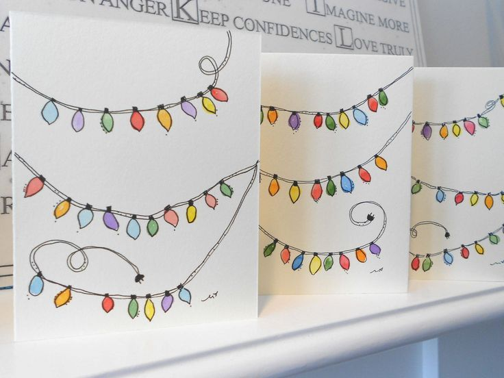 Brightly colored strings of light on wimsical card.