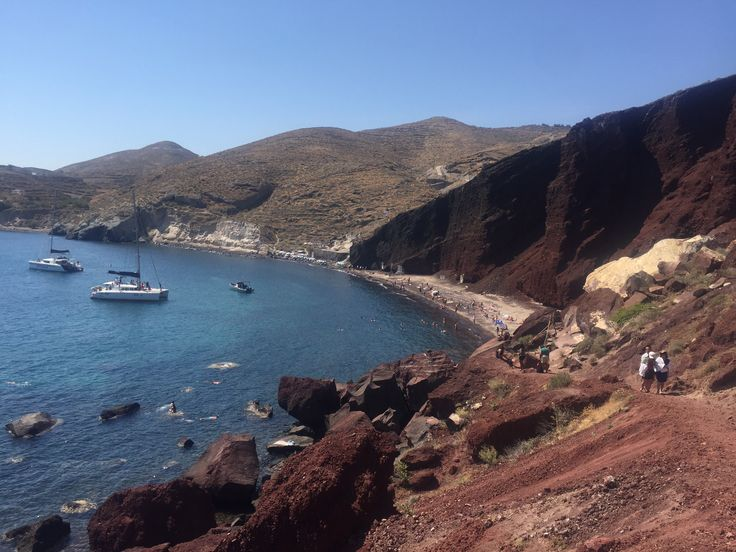 Red Sand beach in Santorini , a must see