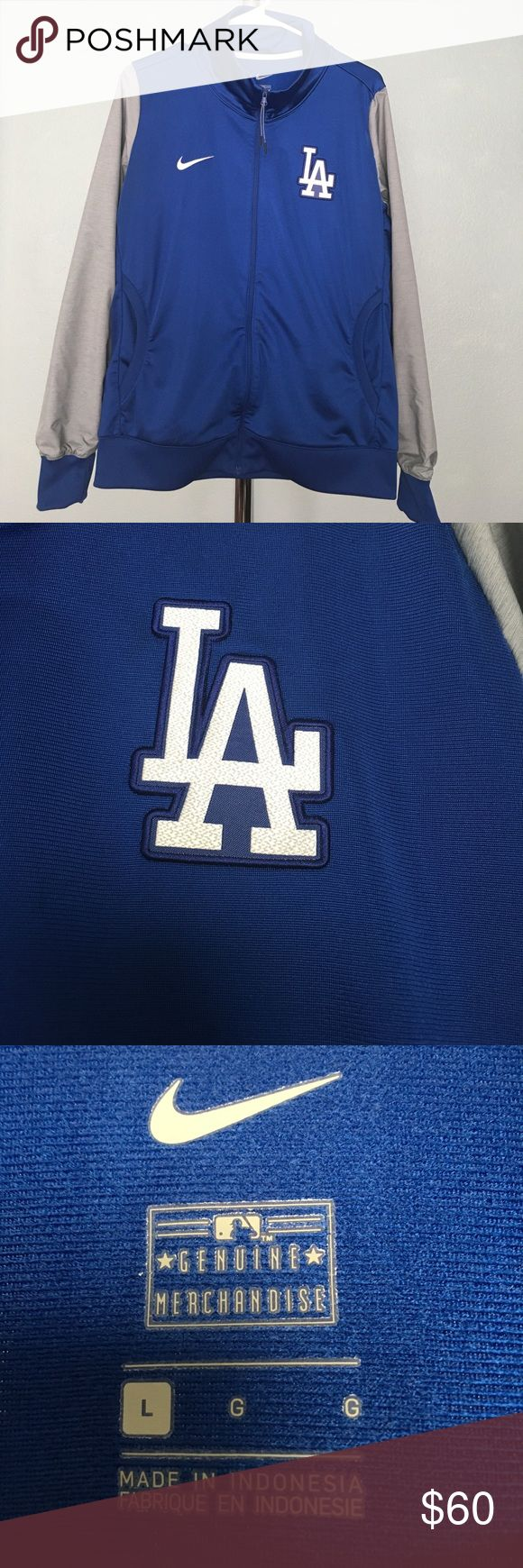 Nike Los Angeles Dodgers Blue Gray Track Jacket This Nike track jacket is Dodger blue and gray. Size is large women's, this is not a unisex jacket. It has the LA logo embroidered on the left breast and the Nike logo on the right. Features 2 pockets on the front plus 2 inside. Purchased at Dodger stadium and worn only a few times. Comes from a smoke and pet free home. Nike MLB Jackets & Coats Utility Jackets