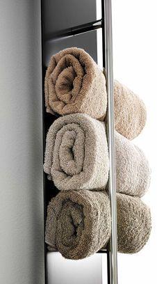 radiateur sèche serviettes à utiliser pour ranger ses serviettes comme ci-dessus Aménager une petite salle de bains