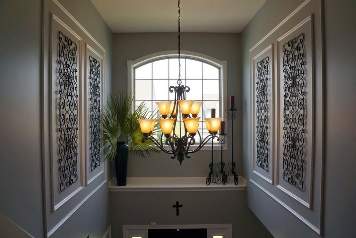 Molding and wrought iron in the two story foyer.