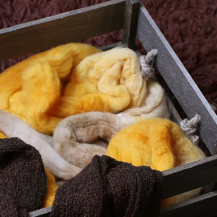 "WOOL BASKET STUFFER $20.00 Newborn photography prop hand made from 100% hand dyed Australian merino wool.5-6m long.Shipped within 24 hoursSpend over $50 and get FREE Express Postage (Australia), or Air Mail (NZ, US, Canada). Use the code ""FREESHIPPING"" at checkout."