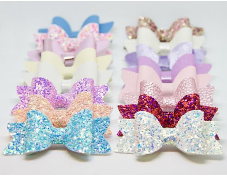 Set of 16 Mixed Leather/Glitter Bows Can be sold as a set or separately.  In this set you will get: 7 Glitter Bows Medium : Cupcake sprinkles, Winter In Wonderland, Rose Gold, Violet, Baby Blue, Dark Princess Pink, Peachy Pink Sparkly Bows. 2 Pearl Leatherette Fabric Bows: Dark Pink and White Pearl 3 Soft Leather Bows : Pink, Cream and Blue 1 Vinyl Shiny White Bow 1 Violet Velvet Bow 1 Pink Mirrored Fabric Bow 1 Violet Thin Sparkly Fabric Bow All bows are medium size.