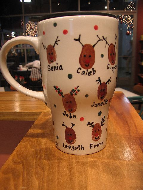 Reindeer thumb print coffee mug.  Got a grandma or grandpa that likes coffee... fun to do with all the grandkids prints. Collect them at thanksgiving when everyone is together and have this ready for Christmas