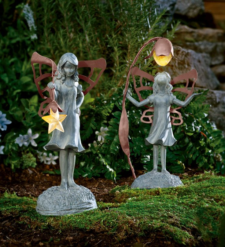 These Decorative Star and Flower Fairies lend a lighter touch to your landscape. With their delicately cut-out metal wings and pixie-ish poses, they add charm to your garden all day.
