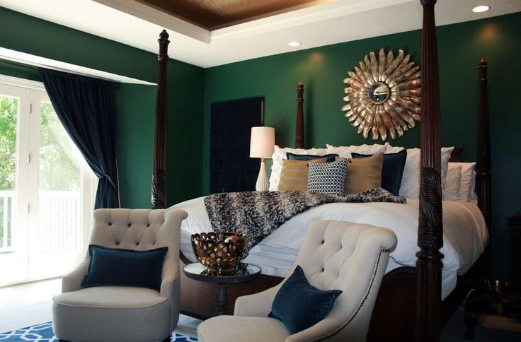 Emerald green bedroom bedroom transitional with white bedding with navy accent pillows white bedding with dark wood bed navy geometric rug in bedroom