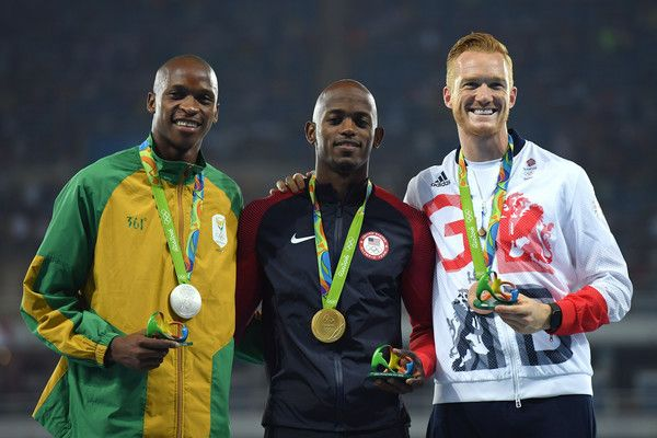 Jeff Henderson (C) of the United States, poses with the gold medal, Luvo Manyonga (L) of South Africa, silver medal, and Greg Rutherford of Great Britain, bronze medal, for Men's Long Jump on Day 9 of the Rio 2016 Olympic Games at the Olympic Stadium on August 14, 2016 in Rio de Janeiro, Brazil.
