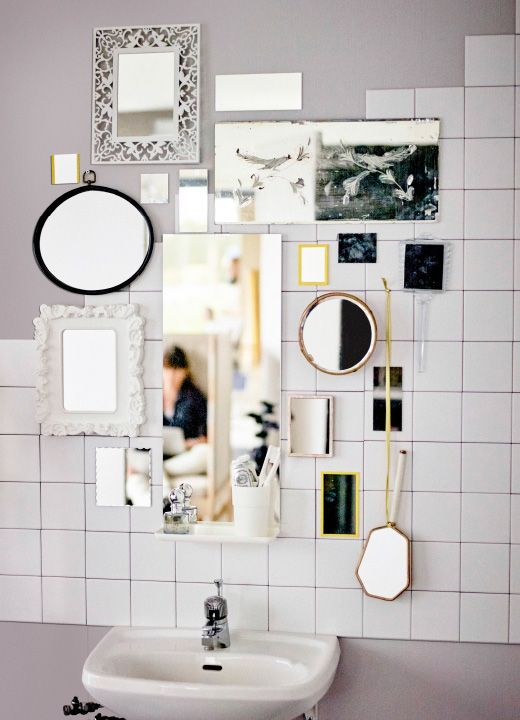 A picture of several mirrors hanging close to each other