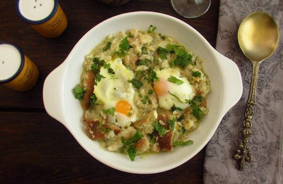 A delicious typical Portuguese recipe confectioned with cod mixed in bread, olive oil, garlic and coriander, served with poached eggs.