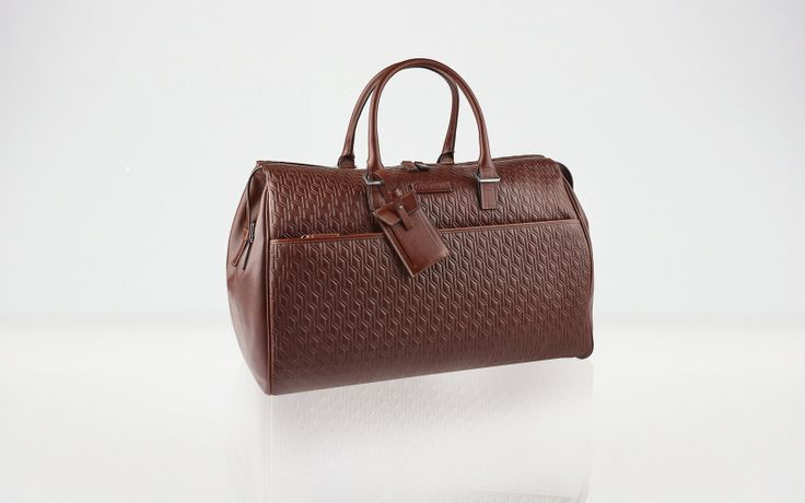 MUSTIQUE  Cabin size travel bag in soft calf leather and vegetable tanned calf leather. Embossed cerruti 1881 logo pattern