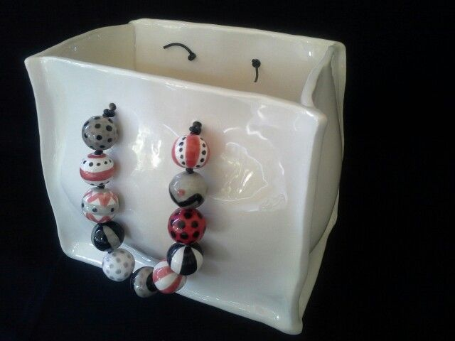DIANE KOTZAMANIS....Bag with bead handle...all ceramic...... Diane Kotzamanis..... https://m.facebook.com/pages/DK-Ceramics/476698149067003