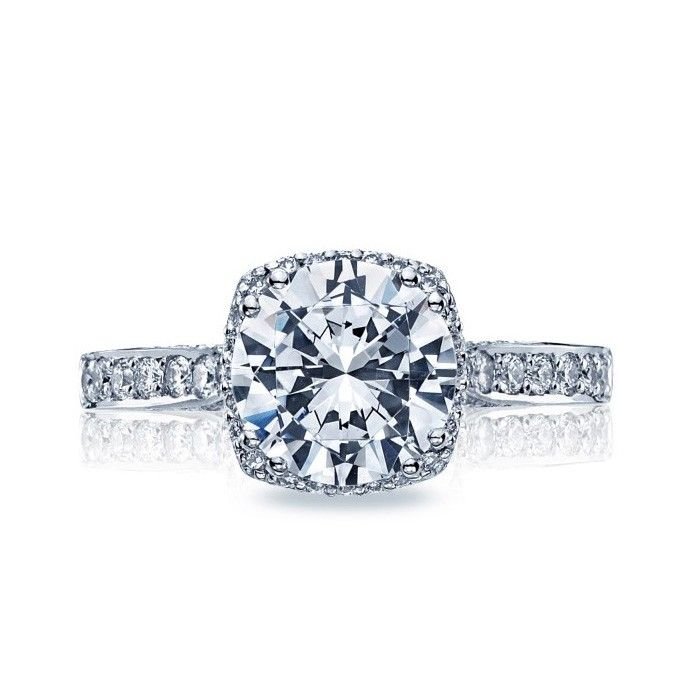 From our Dantela Collection, this unique setting creates a look that is a beautiful juxtaposition of modern, yet traditional; classic, yet unconventional. A stunning, diamond-surrounded round center stone is flanked by pave-set diamonds curving along the shoulders, with signature Tacori details along the sides for a woman with strength and sophistication. $3,131.