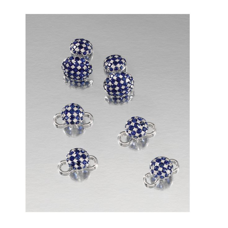 SAPPHIRE AND DIAMOND DRESS SET Comprising: a pair of cufflinks and four studs; each circular link of chequered design set with circular-cut sapphires and brilliant-cut diamonds.
