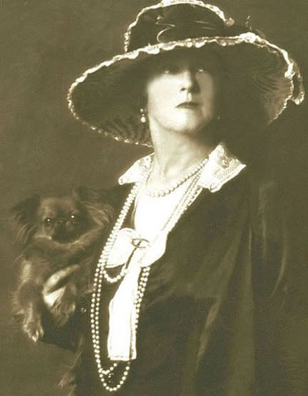 Edwardian couturière and Titanic survivor Lady Duff Gordon, aka Lucile, c. 1927 with her dog