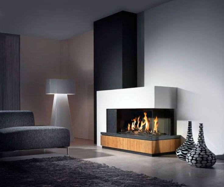 beautiful modern fireplace with white and wood design