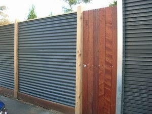Fence with exposed posts and clad in roofing Colorbond - Eco Outdoor Carpentry, Outdoor Home Improvement, West Footscray, VIC, 3012 - TrueLocal