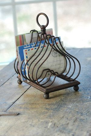 Vintage file holder. So that kitchen and dining room tables don'yt collect all the mail etc