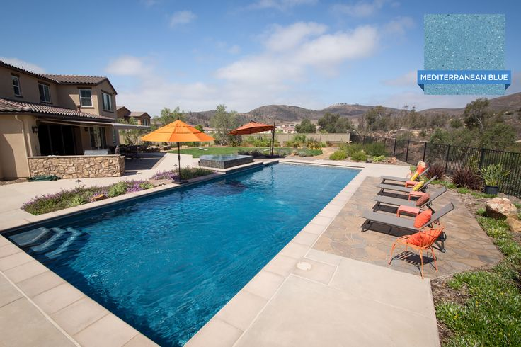 This inviting swimming pool in san diego is finished with for Pool plaster