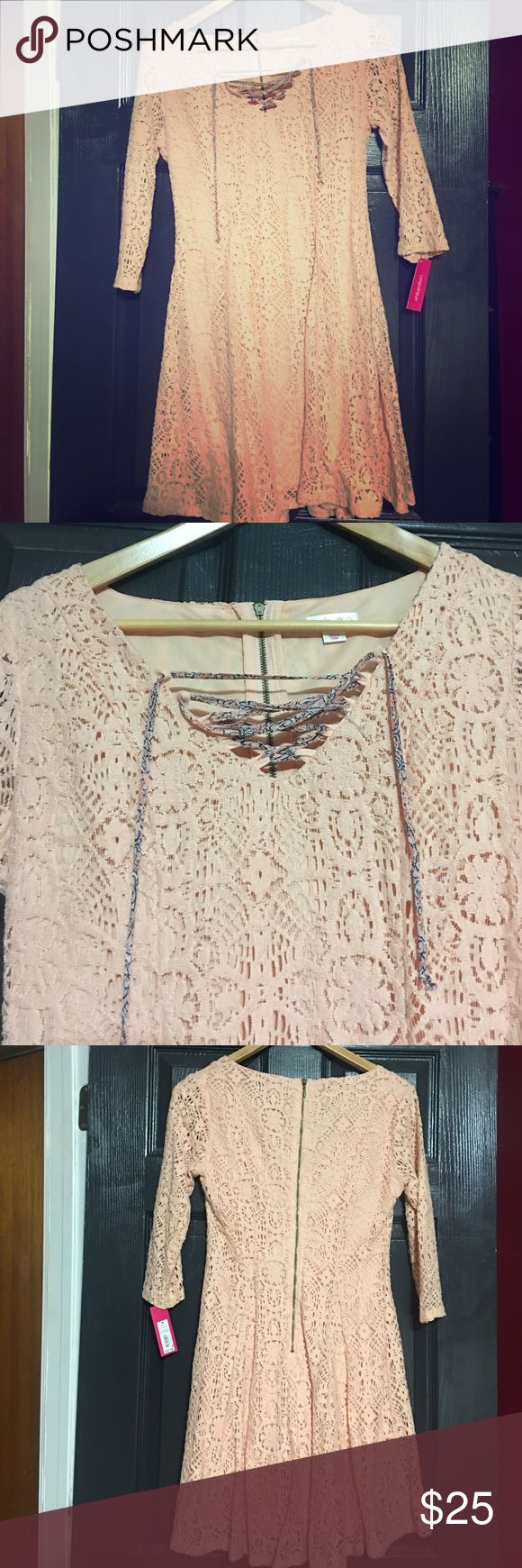NWT peach lace dress From target. All over lace in a peachy color. Zipper in back. Floral string tie in front. Super cute! Size M. Xhilaration Dresses