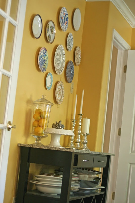 plates on wall, plates to use down below, candle sticks, lemons (oh how I love lemons) = everything just lovely.
