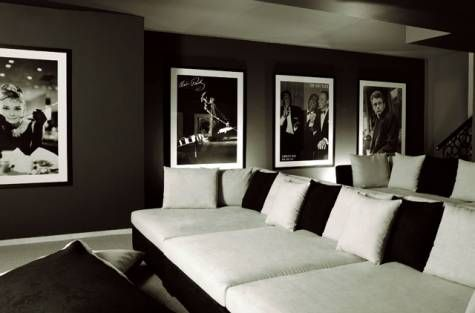 Stadium seating couches for a home theater? Love the black and white. Classy...But I'd rather have black with white accents. White can get so dirty! Home theatre.