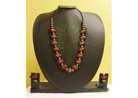 Handmade Terracotta Jewelry - Exclusive Set  An Earthy pendant set in a beautiful design, handmade using river bed clay called terracotta, fired and hand painted with great care. A natural form of heritage Indian art jewelry, painted in earthy hues, mos
