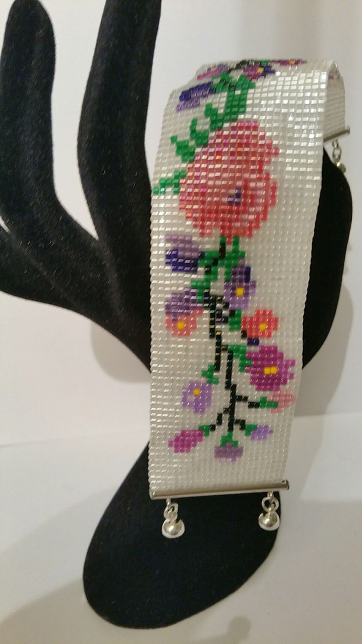 Hand made peyote with flowers. Made from delica beads and miyuki slide with a magnetic lock. A personal favourite from my Etsy shop https://www.etsy.com/listing/266530911/flowers