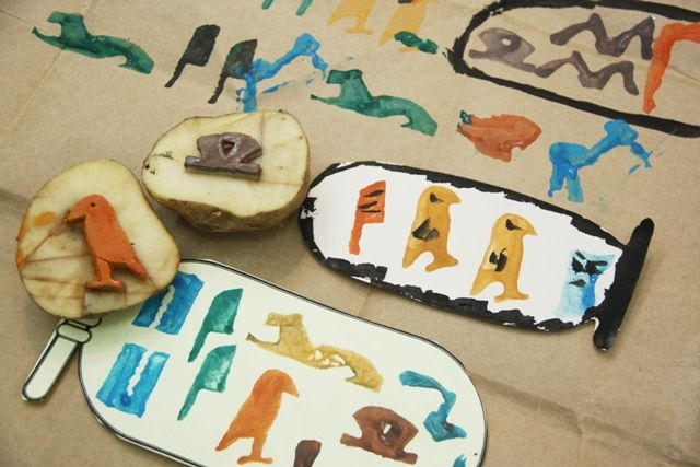 As part of our study of Ancient Egypt, my sixth grade daughter made hieroglyph potato stamps which she used to create both a mural and cartouches.
