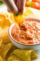 A tasty homemade salsa from fresh tomatoes you can make in your blender in just five minutes!