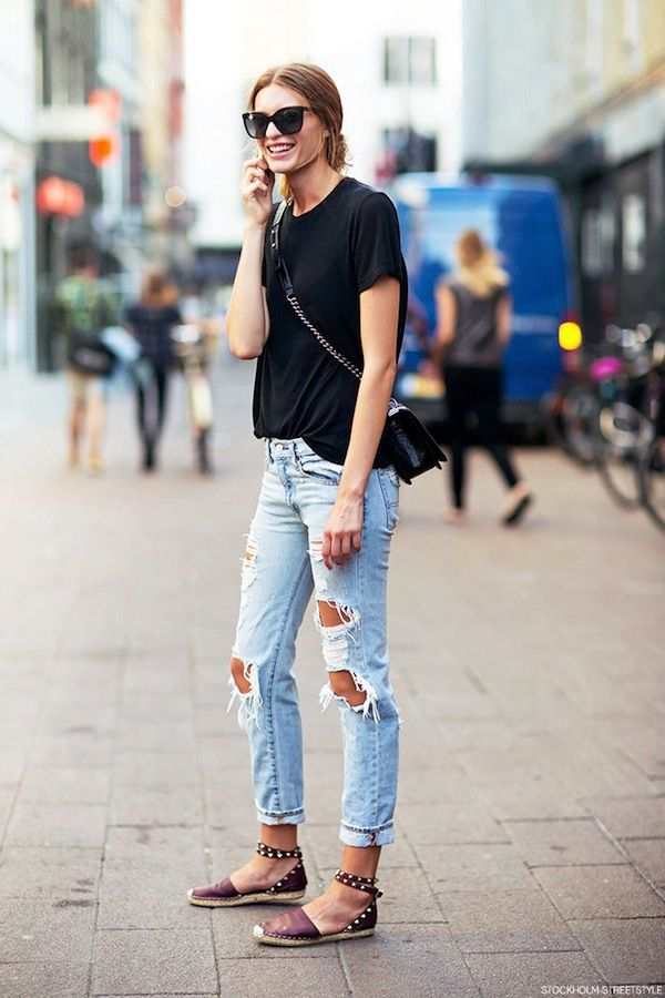 Cristina Mantas // cat-eye sunglasses, black tee, crossbody bag, ripped jeans & studded espadrilles #style #fashion #streetstyle #modelstyle