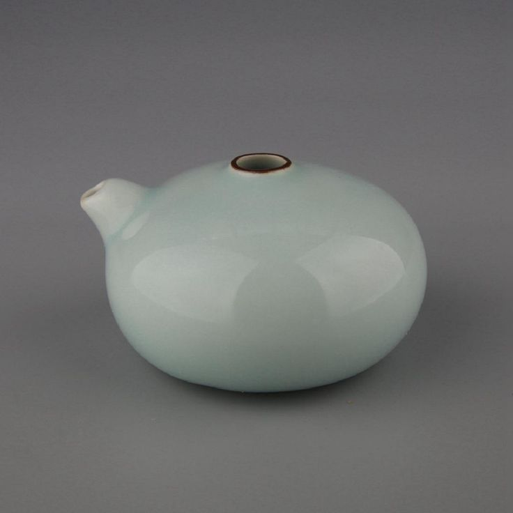 Chinese Celadon Glaze Porcelain Water Pot, Of squat form with a water nozzel