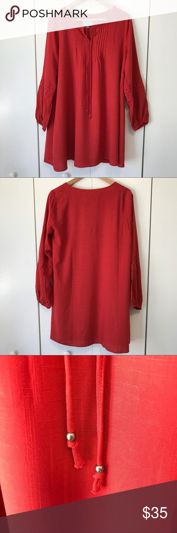 """Stitch Fix Skies Are Blue Red Lace Tunic Dress XS Red tunic dress from Stitch Fix's Skies Are Blue in women's size extra small. Decorative lace detailing on sleeves. Pin tucked front with tie closure at collar. Loose and relaxed fit. Could also be worn as a beach or swim coverup. One small snag in fabric on one sleeve (see picture). 20"""" from armpit to armpit. 23.5"""" from bottom of armpit to bottom of hem. 23.5"""" sleeve length. Skies Are Blue Dresses Mini"""