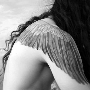 I typically think wing tattoos are cheesy but this is beautiful. If I got wings, this would be what I would get.