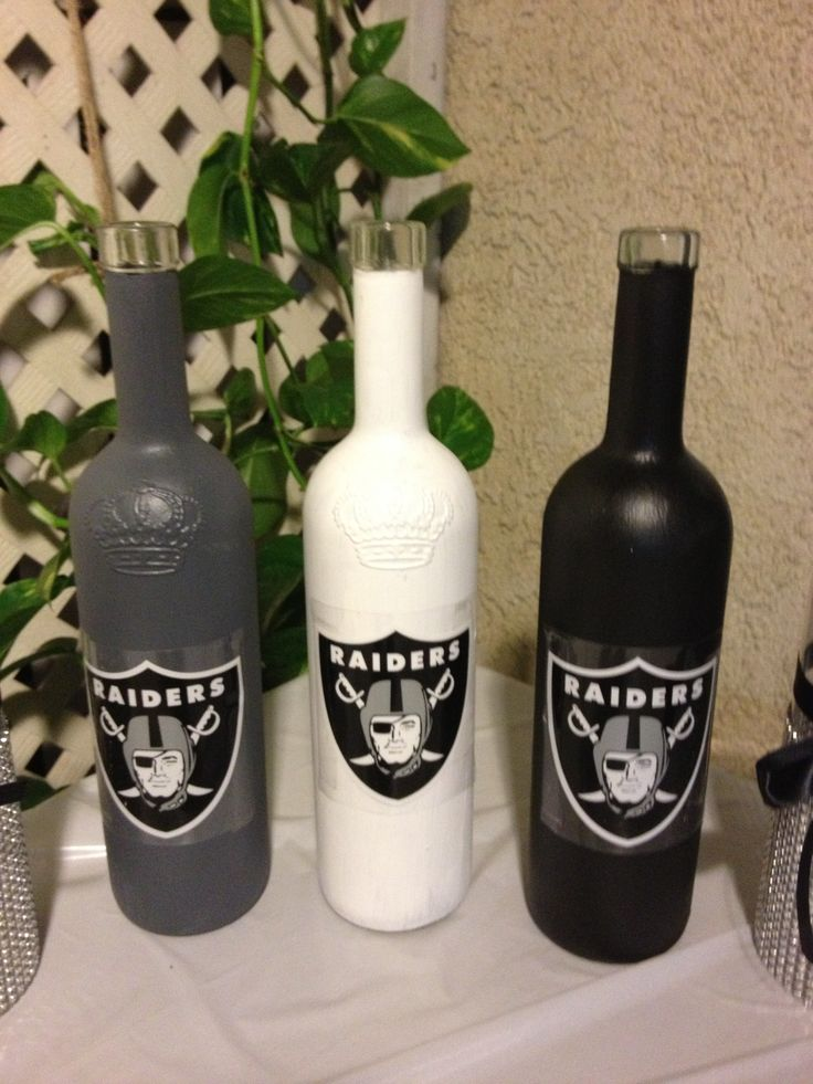 Painted Wine Bottles with team decal used as decor for a Raiders themed party.